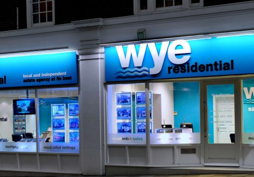 Blue Downlit fascia with window displays and acrylic graphics