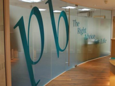 A Frosted window vinyl used to divide an office from a meeting room.