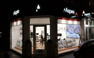 Aspire illuminated shop front with window cling and illuminated interior map
