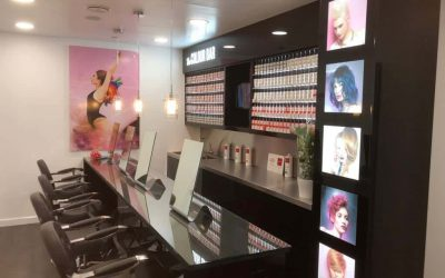 A hair colour bar with illuminated pictures and a poster