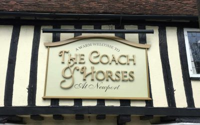 The coach and horses pub gold sign with stand off lettering completed on fascia
