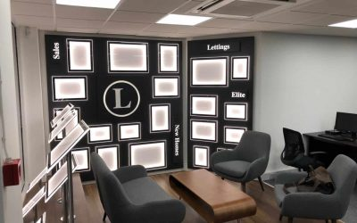 One of our custom lettings displays with illuminated boarders hung on a office wall