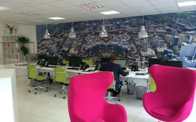 Bespoke wallpaper covering office wall with a mirrored picture of a city.