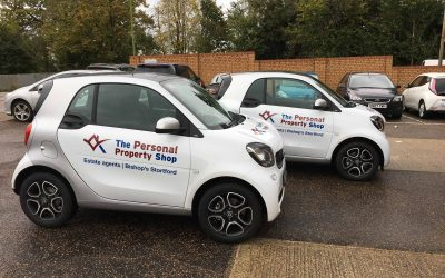 Two fleet cars wrapped with logo