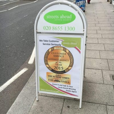 A-board on the pavement showing off business awards