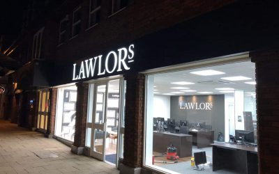 Lawlors shop front illuminated at night just after completion