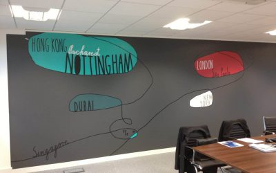 A wall vinyl featuring several popular city names in a colourful design to show all the areas the business trades in.
