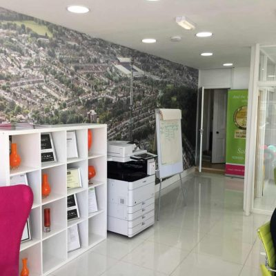 Office setting with a birds eye view of the town printed across one of the walls.